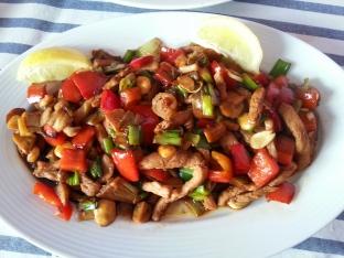 Lomo de cerdo agridulce con verduras salteadas al wok